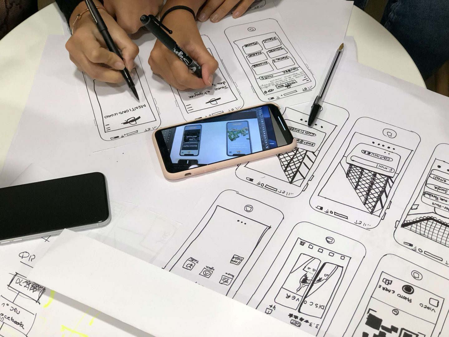 Designing often starts with a piece of paper and a pen to draw initial wireframes of the project.